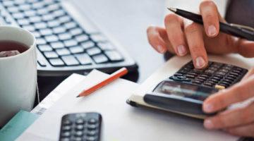 Woman hand using calculator